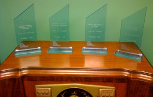 The awards we won on top of one of many console radios owned by Sam