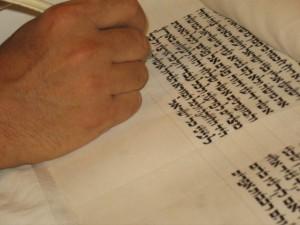 sofer inscribing on scroll